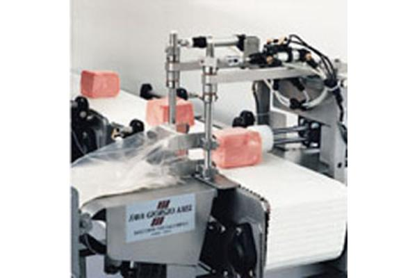 Macchinari industriali: Portions packaging machine